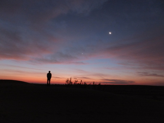 Aaron waiting for the sunrise over the desert