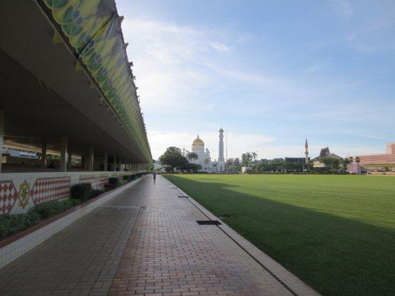Field and grand mosque in Brunei