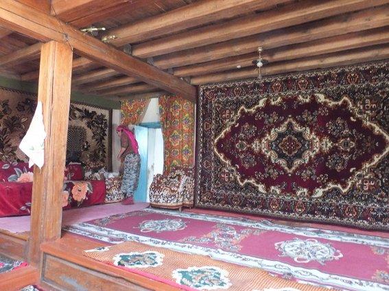 Heavily carpeted Tajik homestay