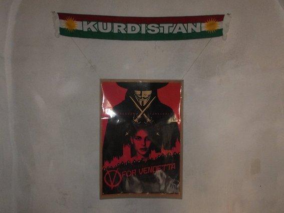 Kurdistan banner, V for Vendetta poster hanging in hosts house in Mardin