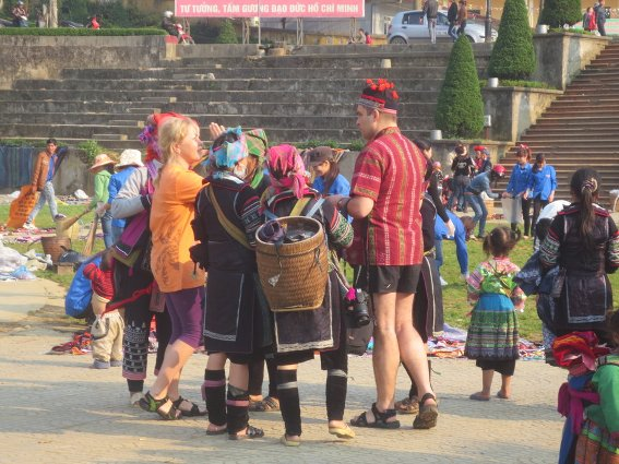 Hmong villagers pushing their wares on some Russians