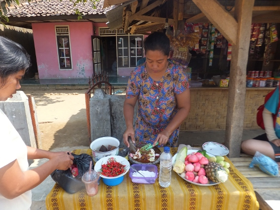 Woman at Sawarna making sweet and spicy fruit and vegetables