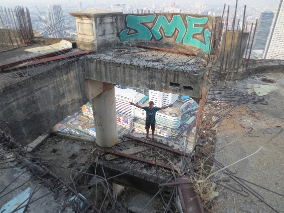 Me on the ledge of the 47th floor of an abandon skyscraper in Bangkok