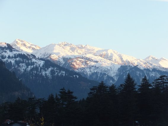 Sunset on the mountains across they valley from Manali