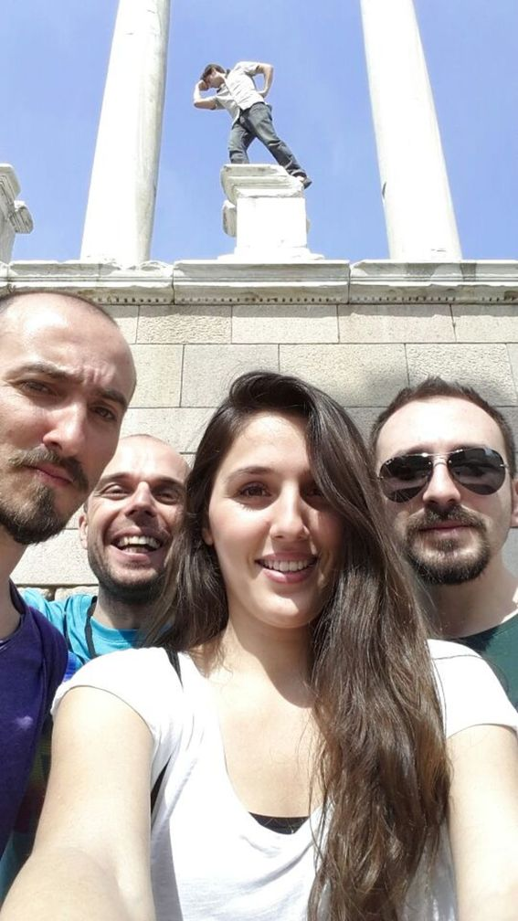 My Izmir friends at Pergamon with me posing as a statue in the background
