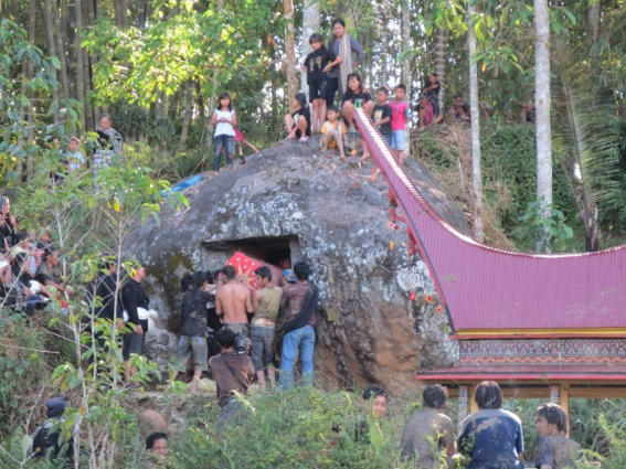 Lempo villages loading a coffin into a rock cave in the mountains of Tana Toraja