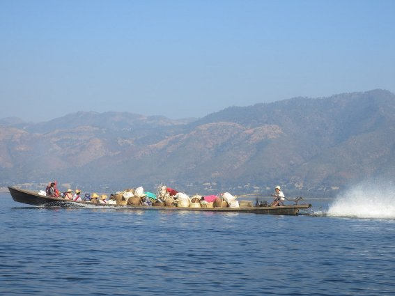 Boat carrying goods and locals in Inle Lake
