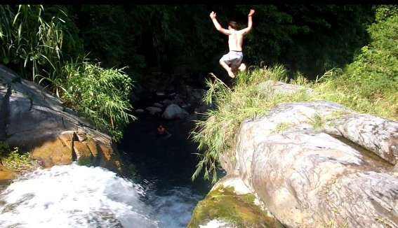 Me jumping off the waterfall